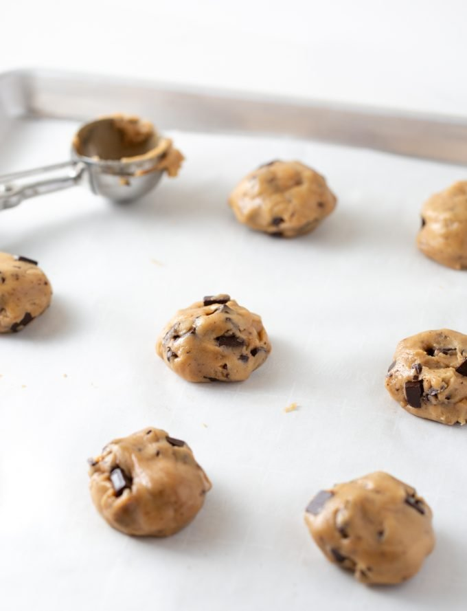 Chocolate chip cookie dough scoops on baking tray