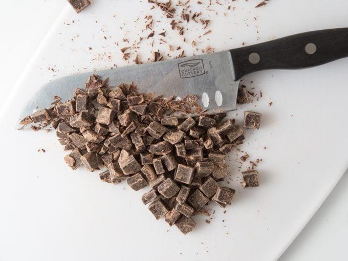 Knife chopping chocolate chunks