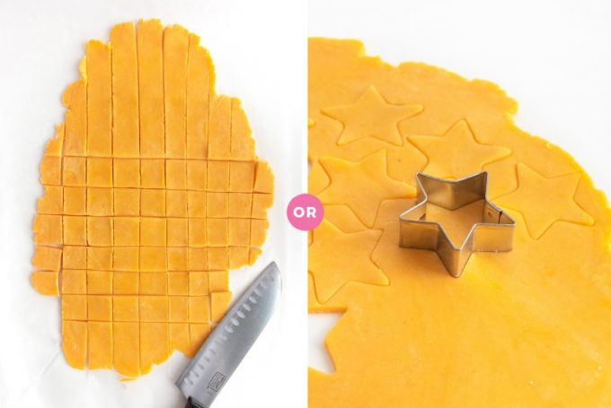 Cutting homemade cheese cracker dough with knife and star cookie cutter