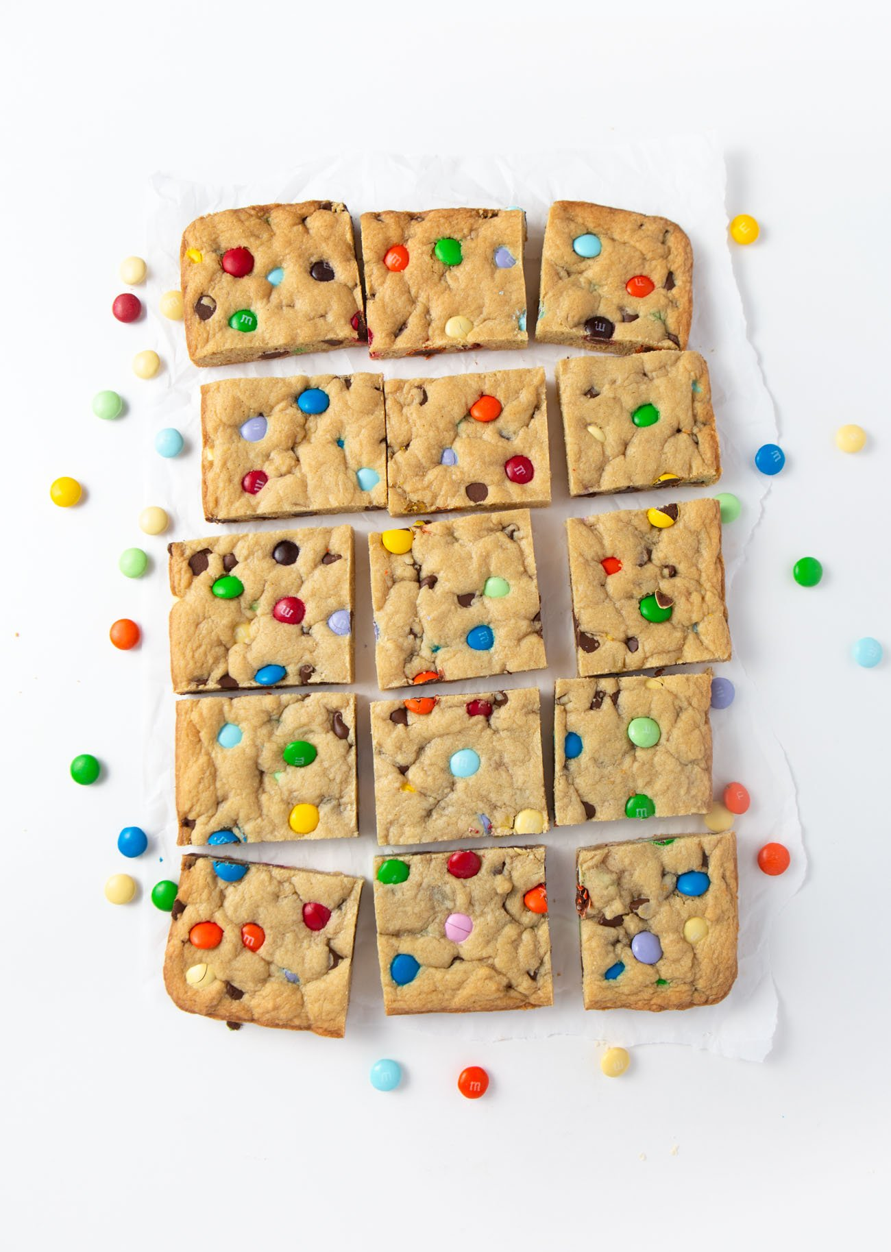 Chewy M&M Cookie bars cut into squares