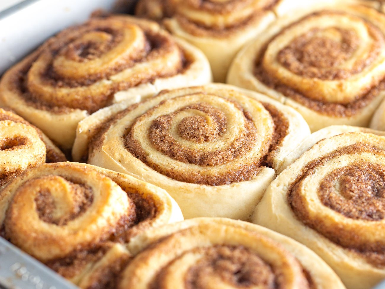 Pan of baked golden 1 hour cinnamon rolls