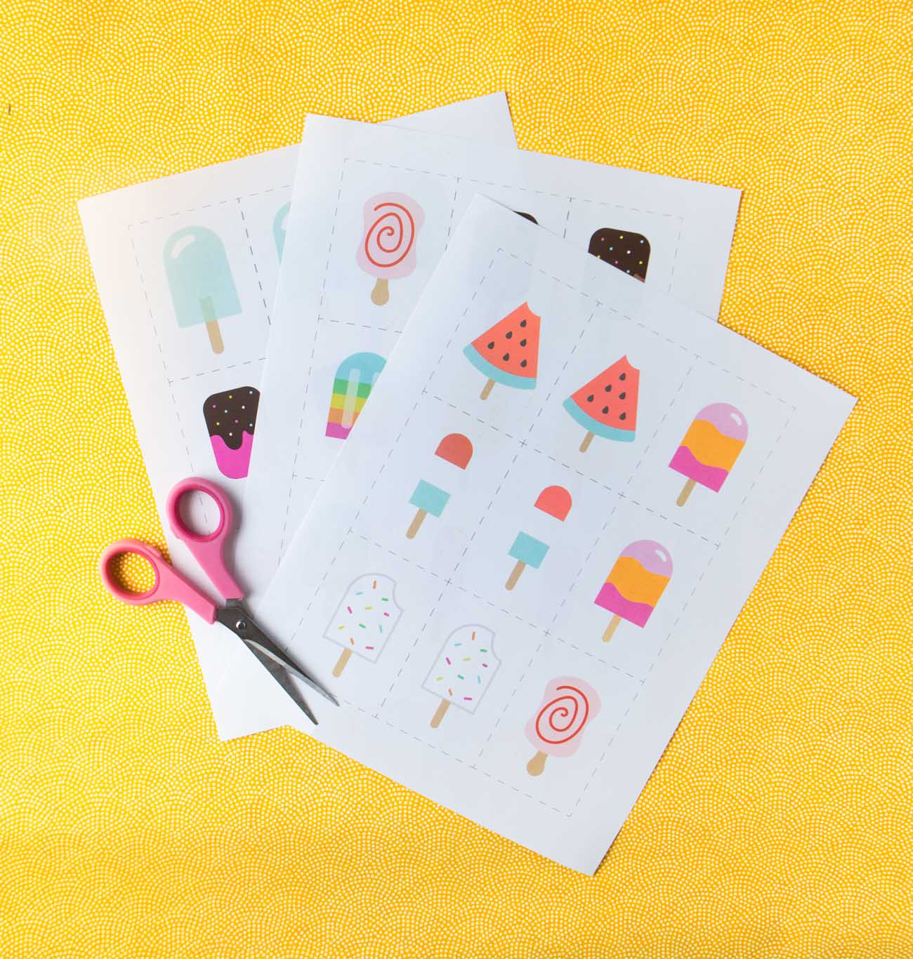 Printed sheets of paper with printable memory cards and scissors