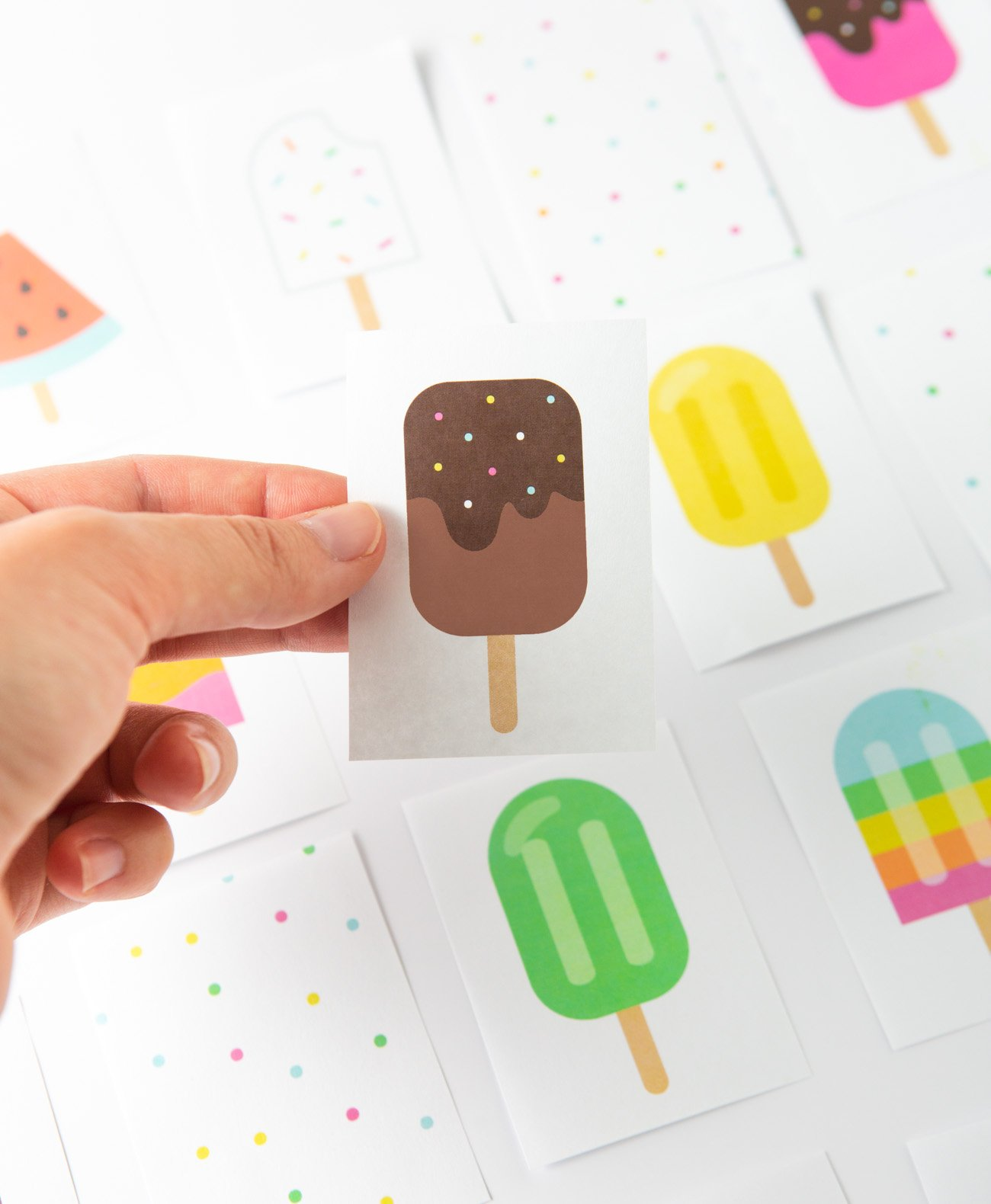 Hand holding chocolate popsicle printable memory card