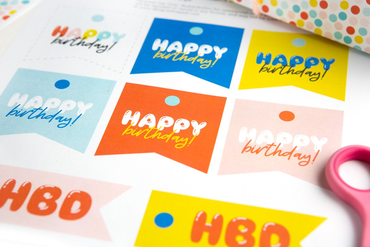 Sheet of colorful Free Sheet of Printable Happy Birthday Tags with phrases HBD, YAY, and Happy Birthday!