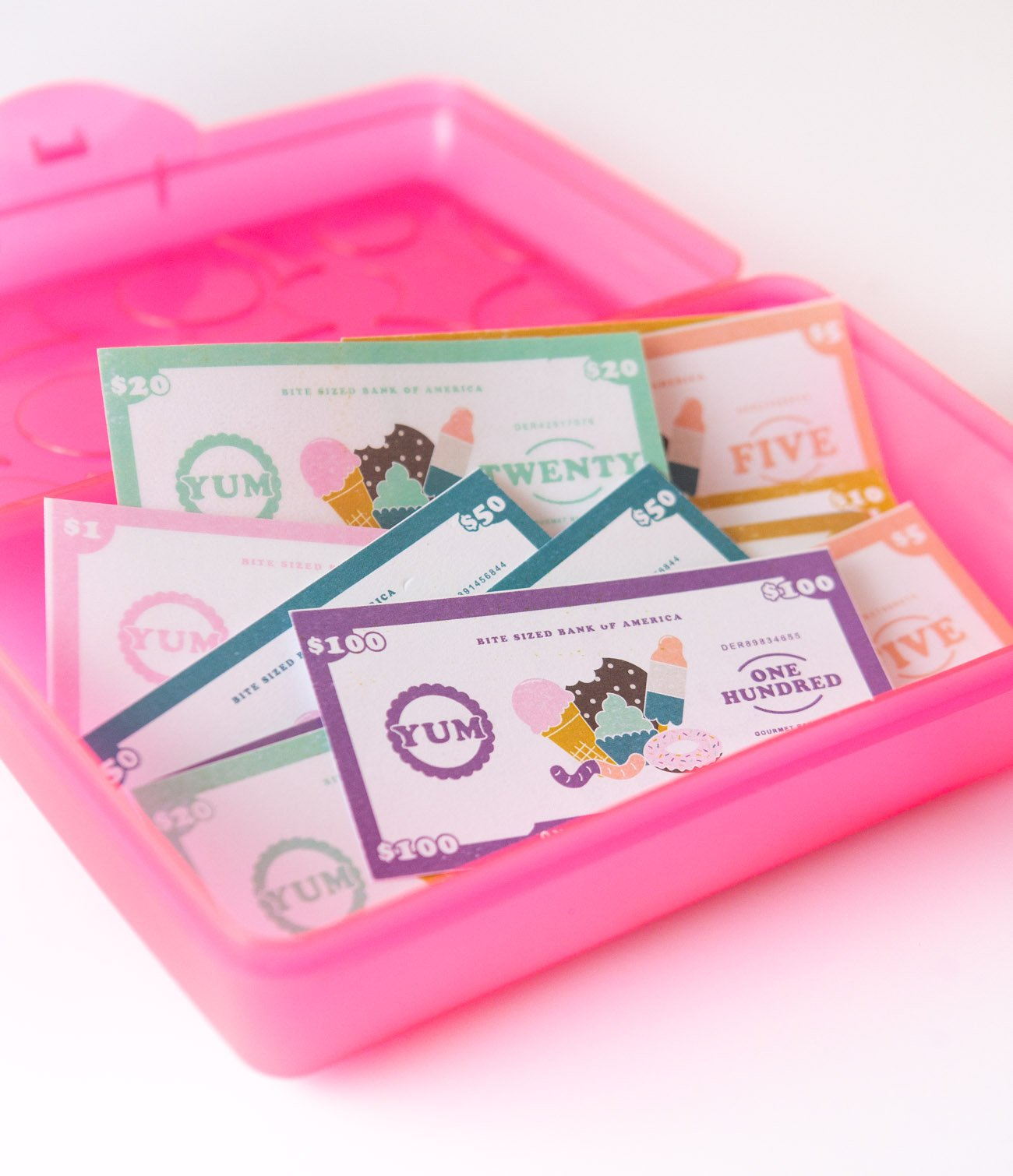 Storage for dessert themed free printable play money for kids, $1, $5, $10, $20, $50, $100