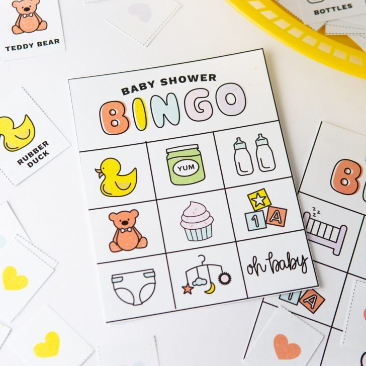Baby shower bingo cards with pictures and icons; rubber duck, teddy bear, bottles, cupcake, diaper, blocks, baby food