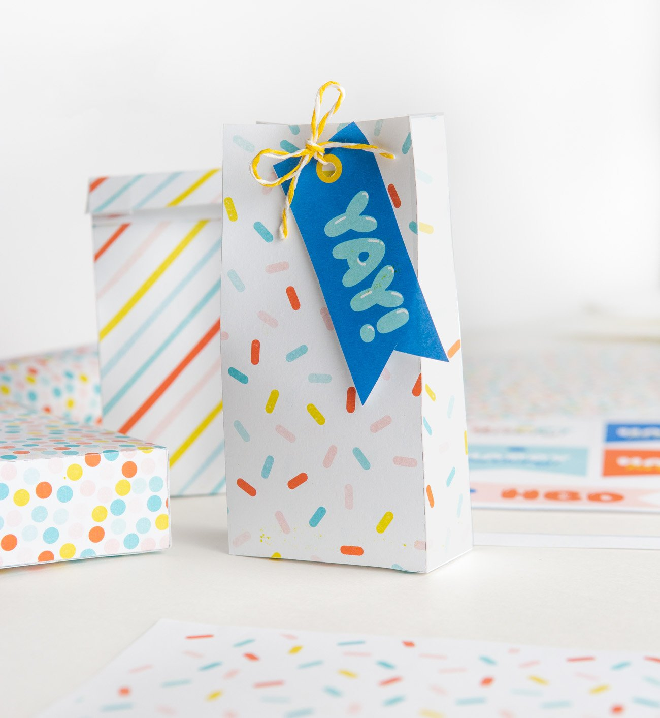 Colorful sprinkle printable treat bag with blue YAY birthday printable gift tag