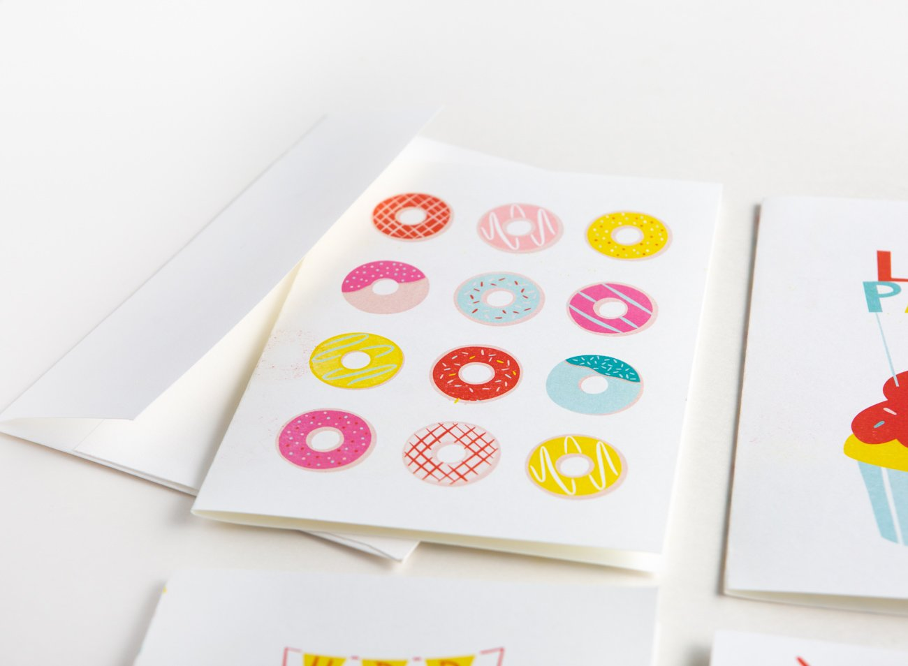 Free donut printable birthday card with rainbow donuts and sprinkles