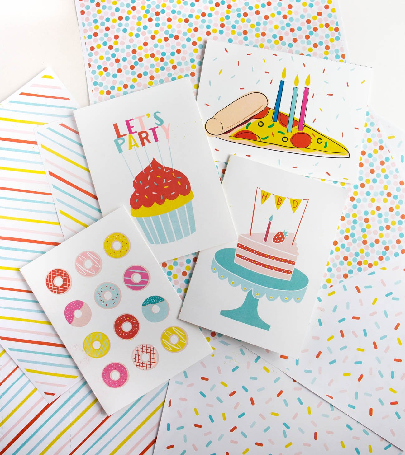 Four free printable birthday cards with donuts, cupcake let's party, pizza, and cake with HBD message