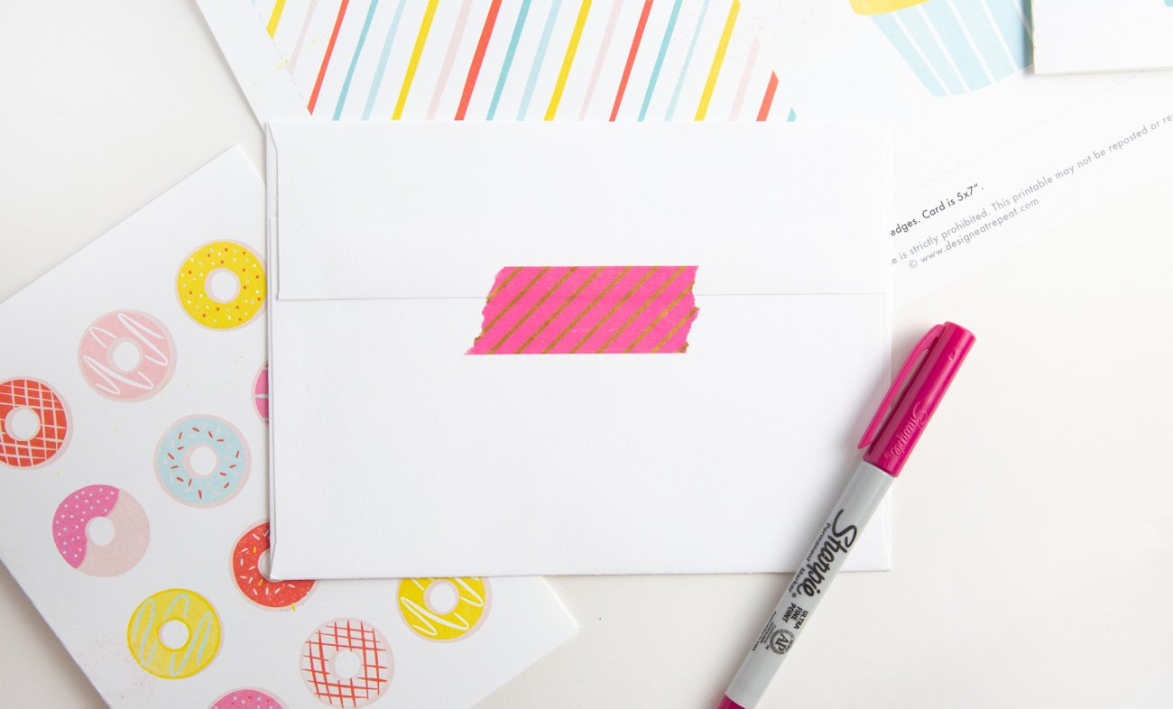 Envelope with pink washi tape for free donut printable birthday card with rainbow donuts and sprinkles
