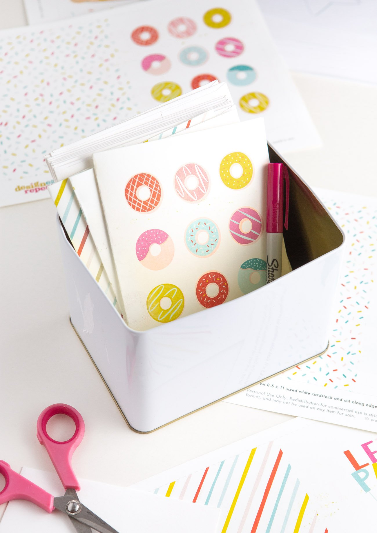 Free donut printable birthday cards in a tin box for a greeting card storage