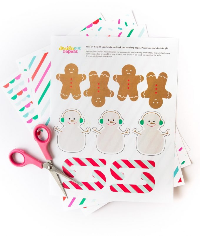 Printed sheet of Snowman, gingerbread man, and candy cane printable Christmas gift tags