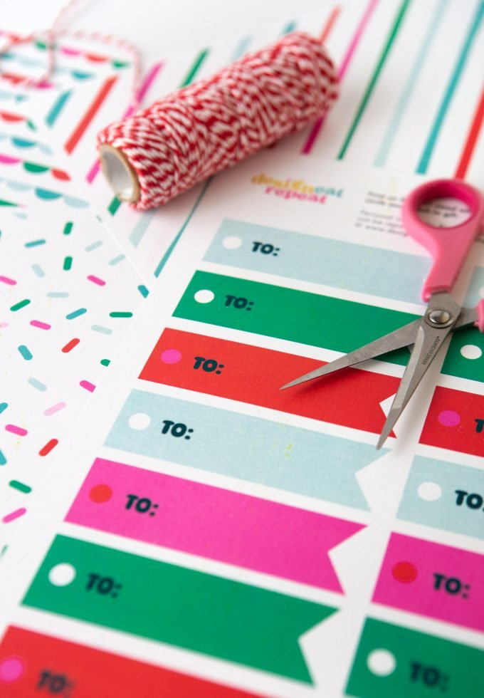 "Printed sheet of green, red, pink, and blue printable Christmas gift tags ""TO"""
