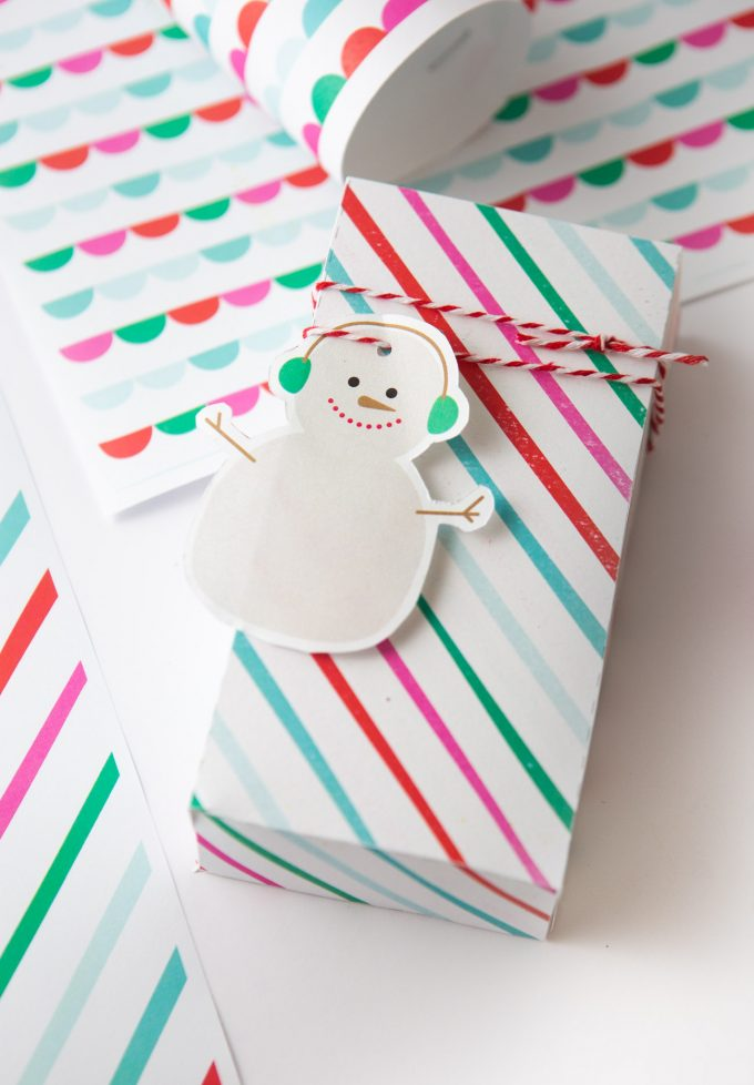 Printable snowman gift tag on striped rainbow gift box