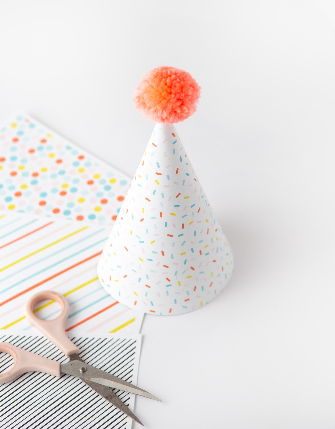 Sprinkle pattern party hat made with printable scrapbook paper