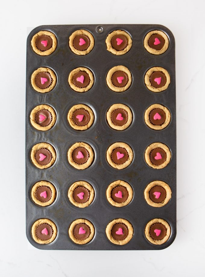 Mini muffin tin pan of Reeses Peanut Butter Valentines Cookie Cups