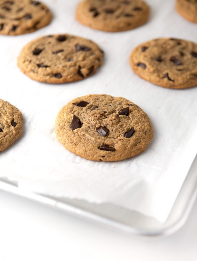 Baking tray of peanut butter chocolate chip cookies on parchment