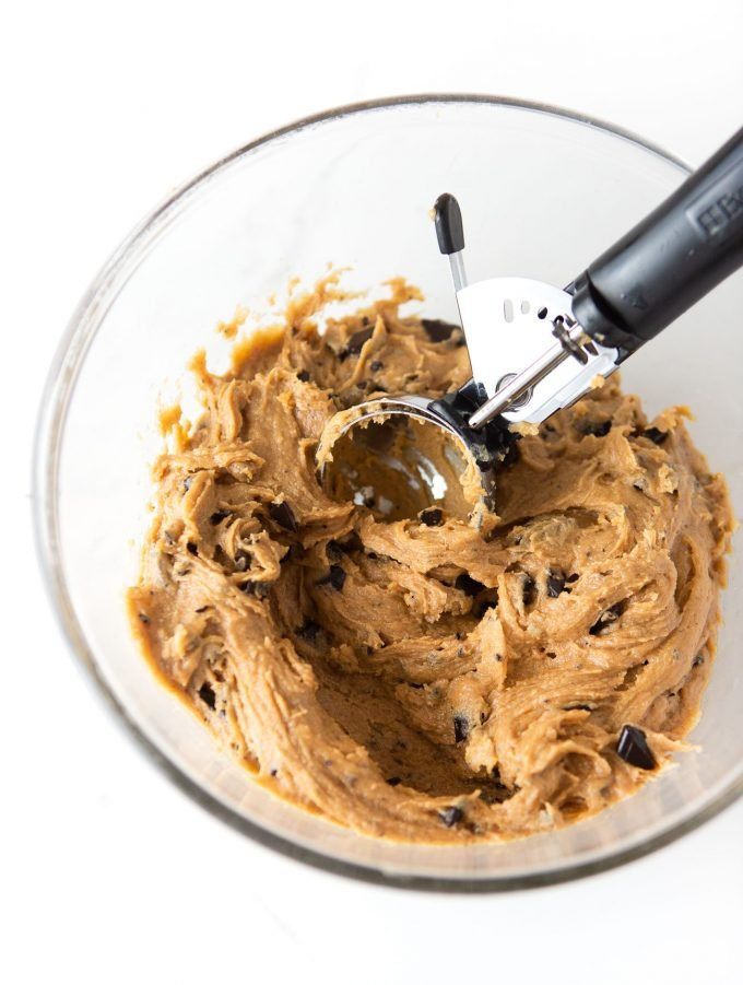Bowl of peanut butter chocolate chip cookie dough with 3 tablespoon cookie scoop