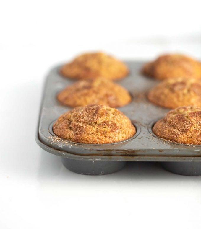 Metal muffin tin of banana muffins