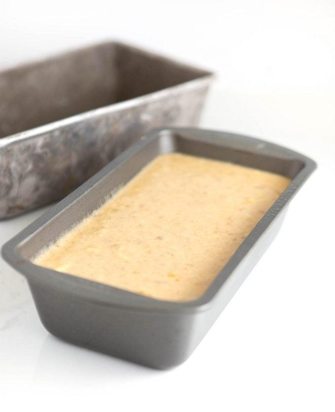 Metal loaf pan filled 2/3 full with banana bread batter