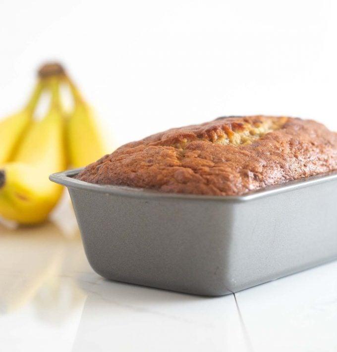 Pan of moist banana bread in metal loaf pan
