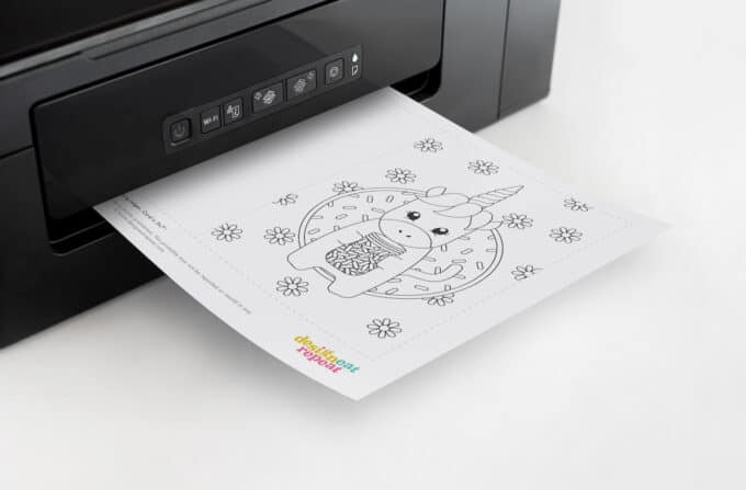 Printer with unicorn birthday card coming out