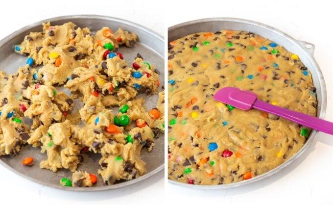 Pressing M&M cookie cake dough into round cookie cake pan