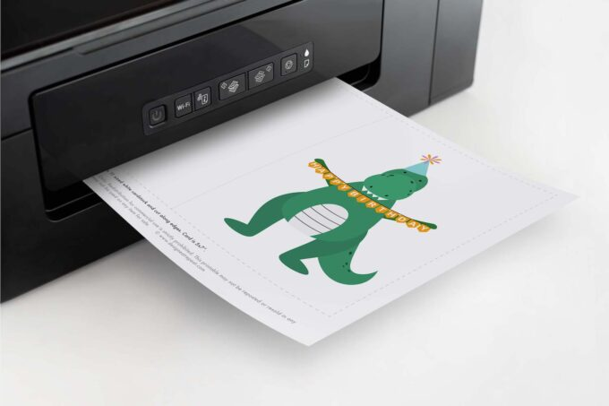 Printer printing a printable dinosaur birthday card