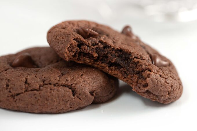Chocolate cake mix cookies with bite showing soft and fudgy texture