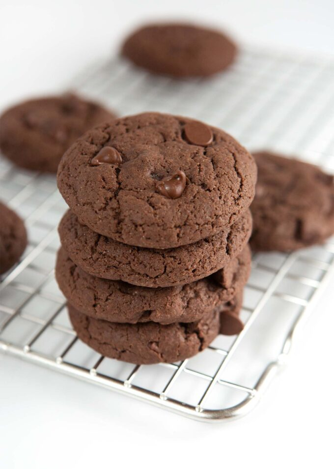 Stack of chocolate cake mix cookies on cooling rack