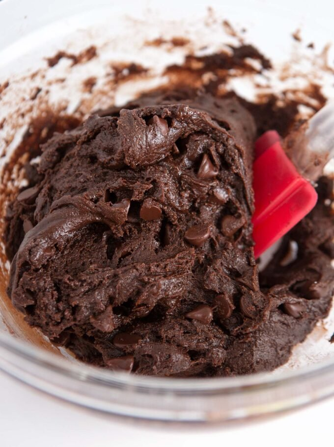 Chocolate cake mix cookie dough with red spatula