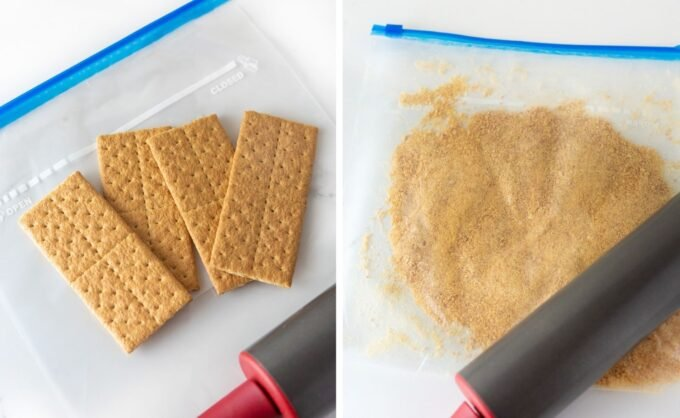 crushing graham crackers into crumbs in ziploc bag with rolling pin