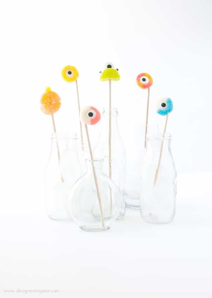 Colorful gummy candy rings on wooden skewers for halloween drink toppers
