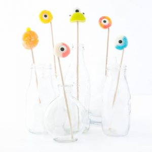All you need are skewers, gummy rings, and candy eyeballs to make these DIY Halloween Drink Stirrers! Such an easy & cute idea!jpg