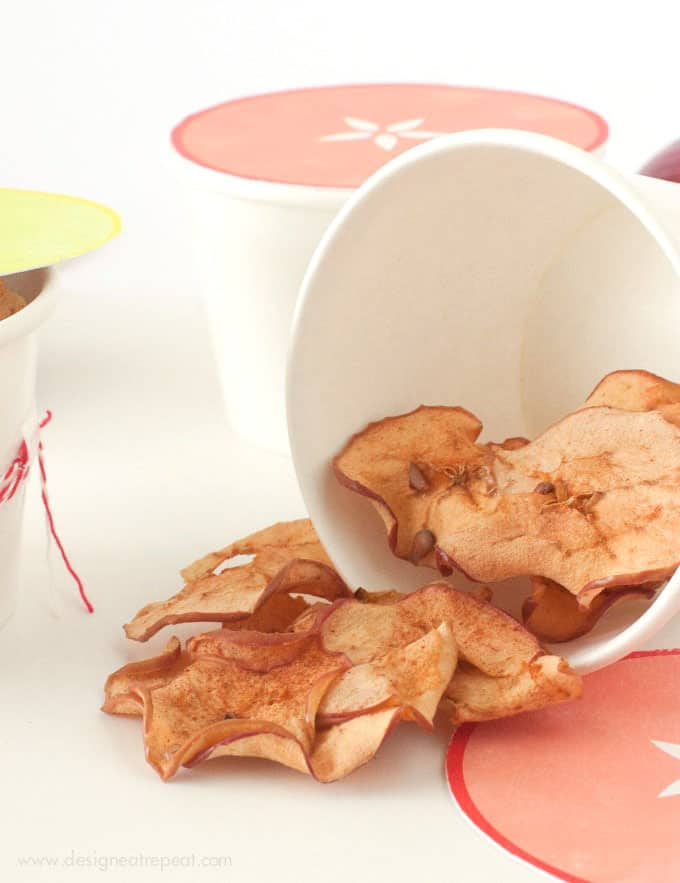 Baked apple chips in cute packaging container.