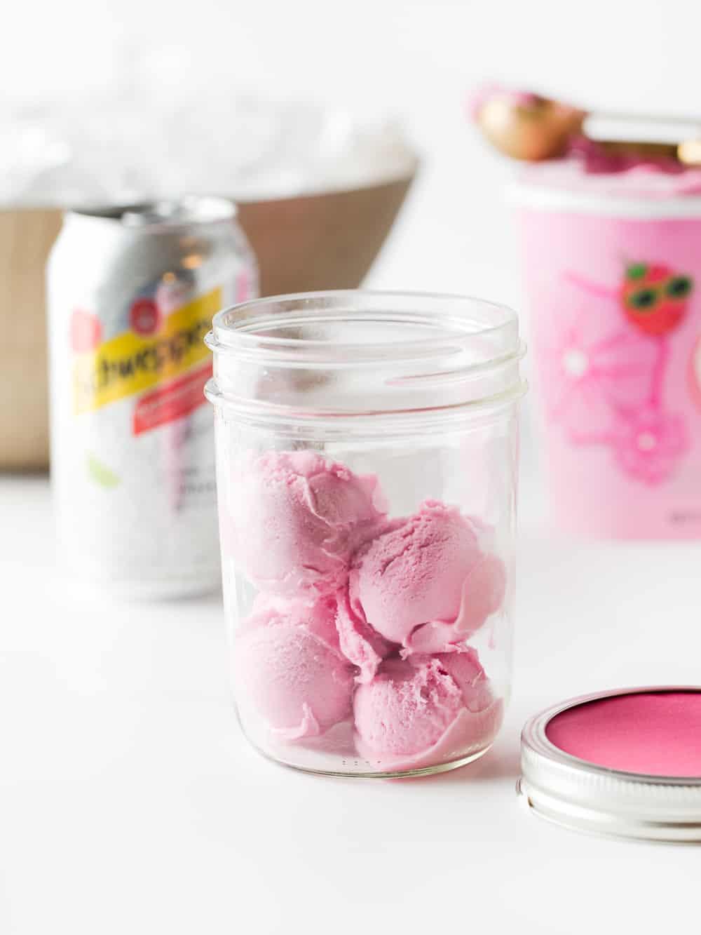 Scoops of raspberry sherbet in mason jar to make DIY punch bar.