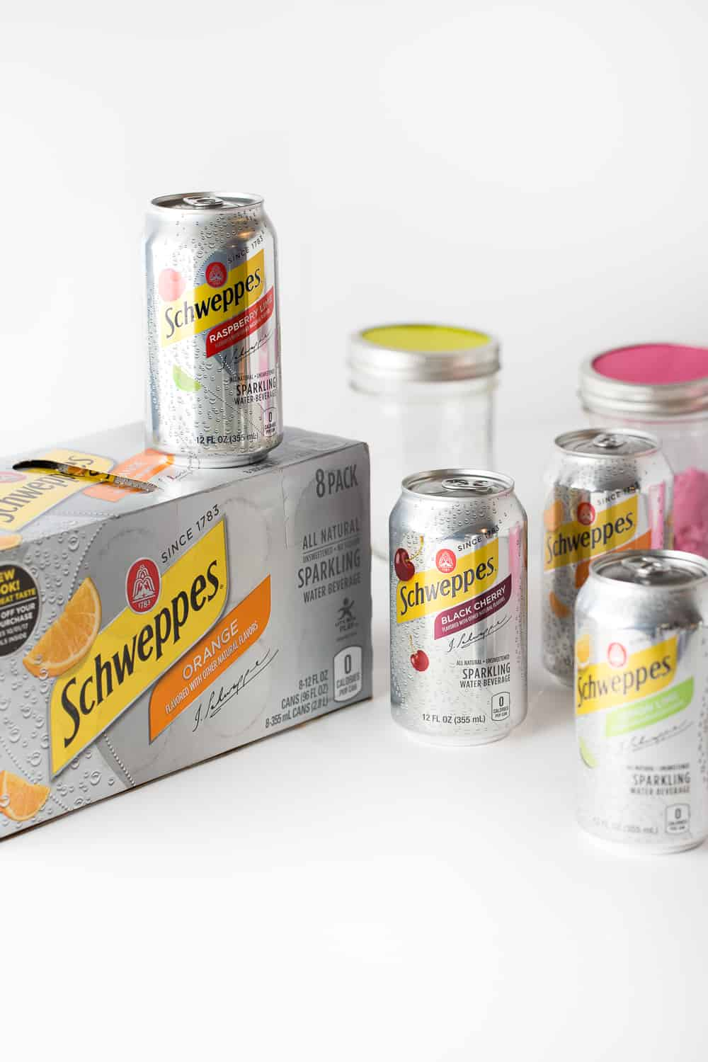 Cans of Schweppes Sparkling Water to make DIY Punch Bar