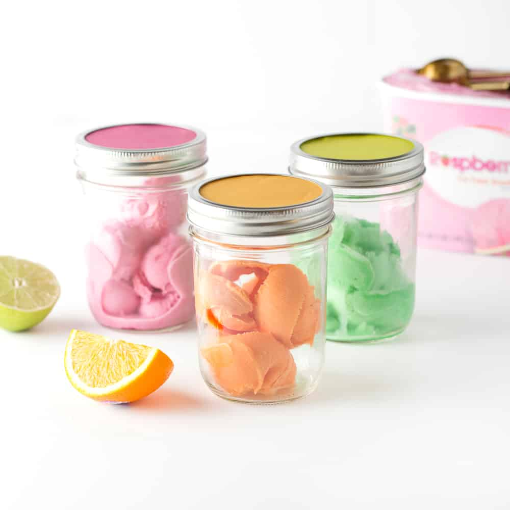 Raspberry, Orange, and Lime Sherbet scoops in mason jar to create DIY punch bar.