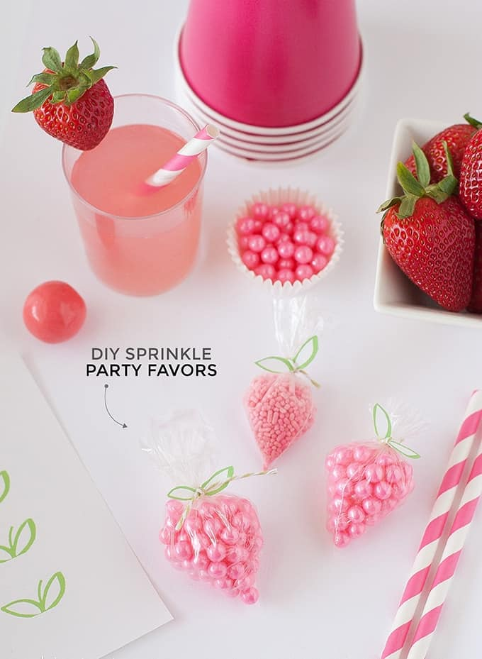 "DIY Strawberry Sprinkle Party Favors | All you need is a plastic bag, string, sprinkles, and the free ""leaf"" printable found on Design Eat Repeat. So easy & fun!"
