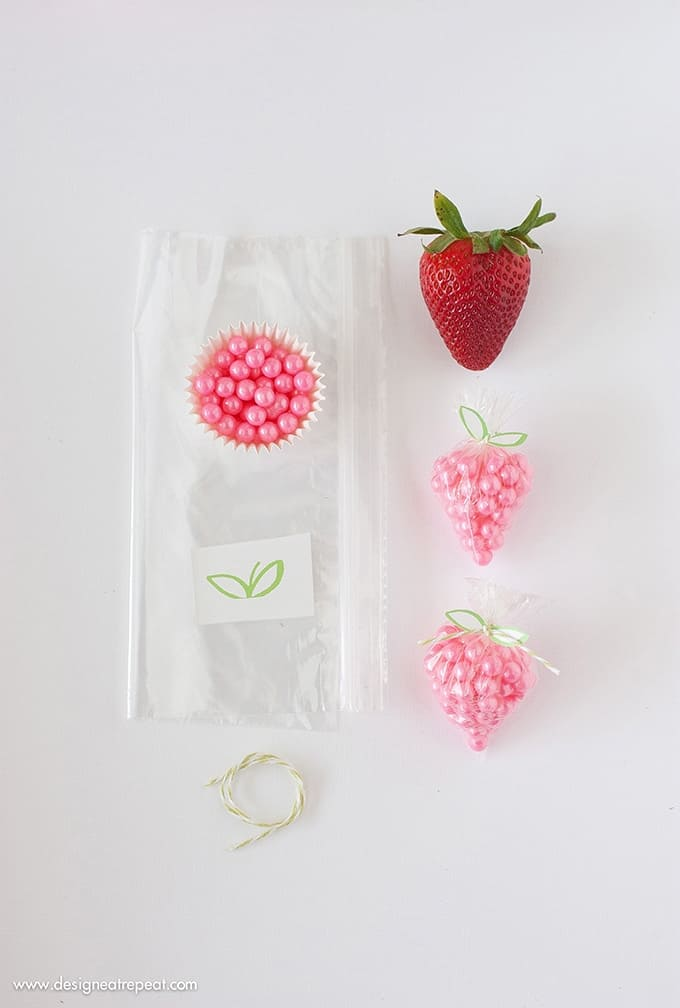 "DIY Strawberry Sprinkle Party Favors | All you need is a plastic bag, string, sprinkles, and the free ""leaf"" printable found on Design Eat Repeat. So simple & fun!"