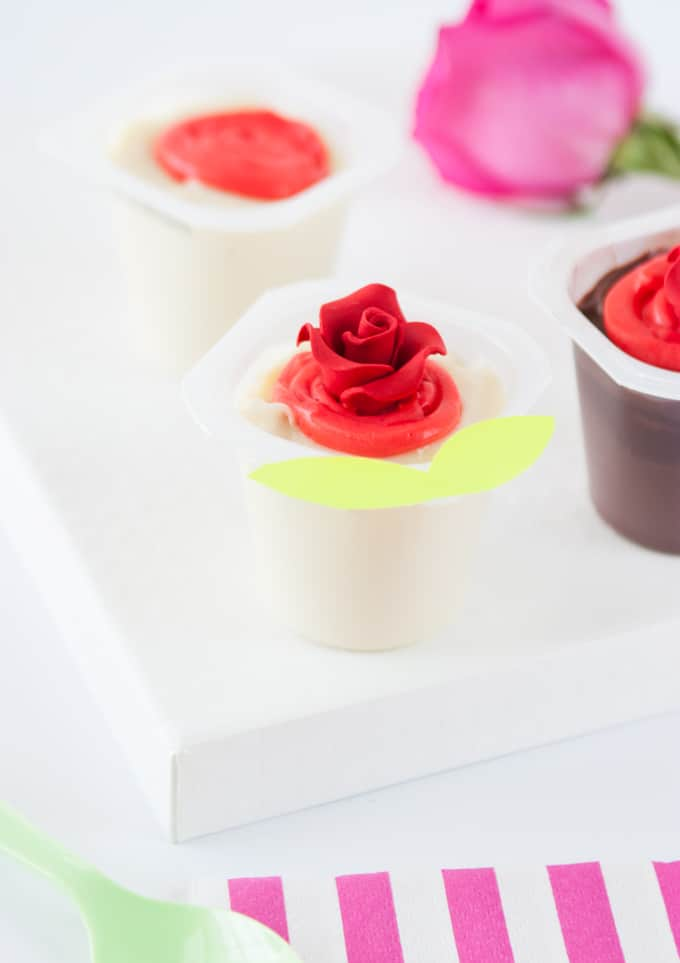 Dye vanilla pudding red and swirl on top of Snack Pack pudding cups to create Valentine's Day roses! So fun and EASY!