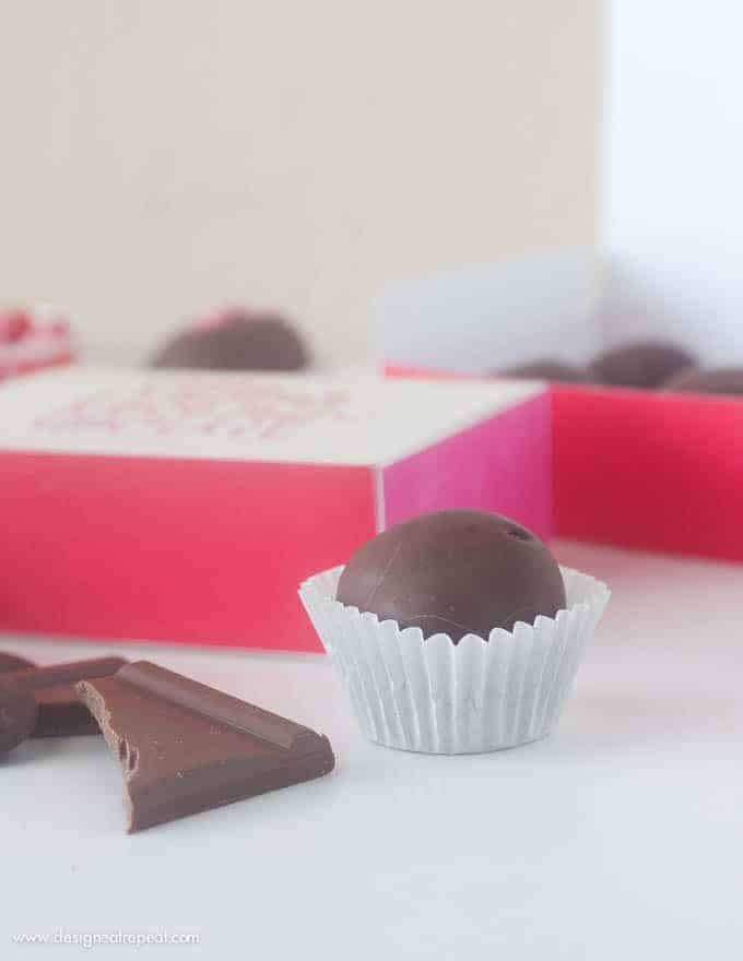 "Homemade chocolate truffles in free Printable Chocolate Gift Box with phrase ""there is no greater love than chocolate""."