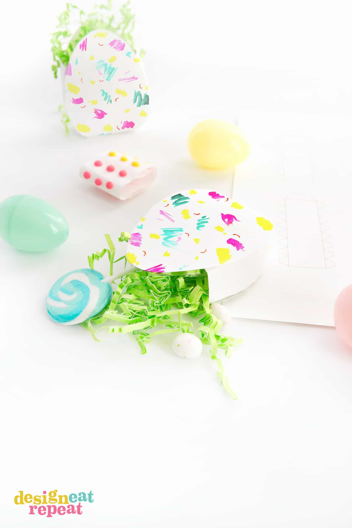 Download these bright & colorful Easter Egg Candy Boxes for a fun way to gift treats & trinkets!