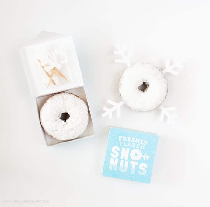 Freshly Baked Donuts? Pssh, how about Freshly Flaked Sno-Nuts! Download this free printable donut box kit from Design Eat Repeat for a fun addition to your holiday or Frozen party! Love it!