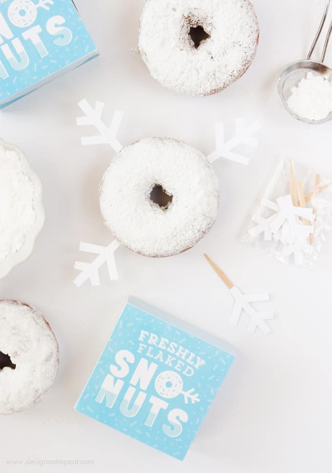 Freshly Baked Donuts? Pssh, how about Freshly Flaked Sno-Nuts! Download this free printable donut box kit from Design Eat Repeat for a fun addition to your holiday or Frozen party! So fun!