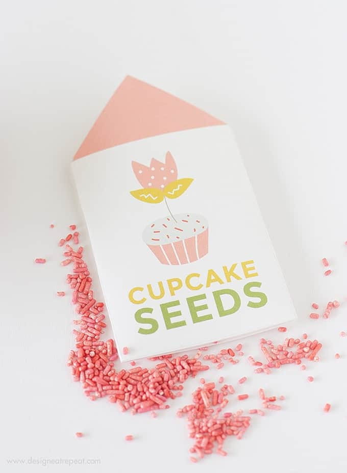 "Learn ""How to Grow A Cupcake"" with these free springtime printables by Design Eat Repeat! Includes the instructions on how to create these ""Cupcake Seed"" packets, that include a tulip topper & sprinkles! Great for a party activity or party favor!"