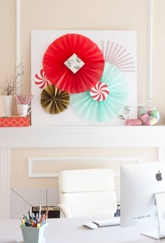 Learn how to make DIY Tissue Paper fans to create photobooth backdrops or holiday fireplace decor!