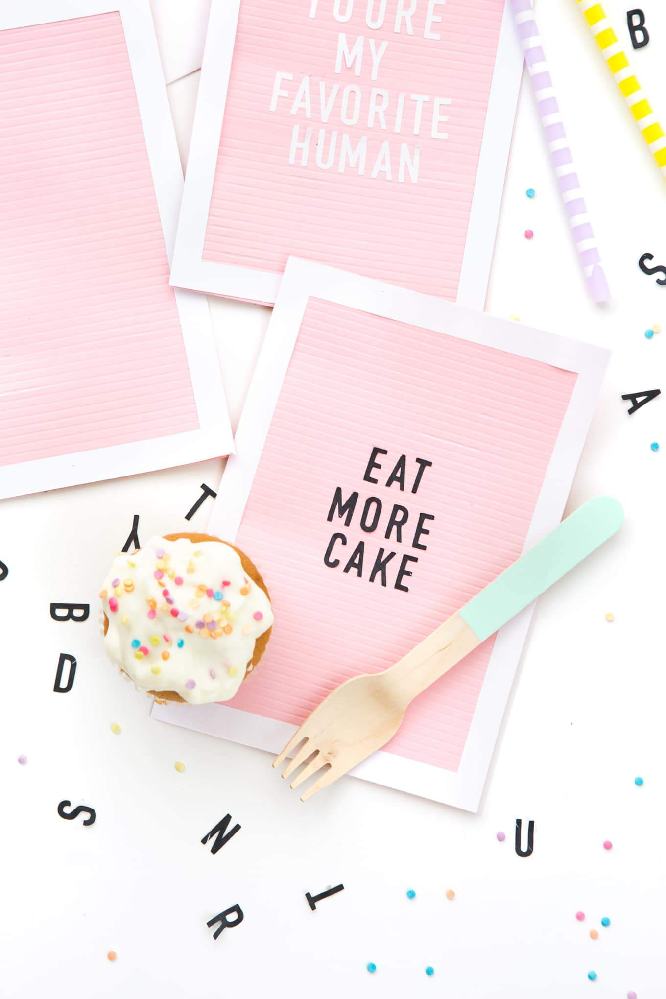 Pink letterboard DIY birthday card that says Eat More Cake