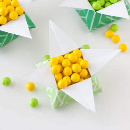 "Looking for a easy St. Patrick's Day craft? Print off this FREE paper & follow the tutorial to make a origami ""Pot of Gold"" box. Fill with candy for a fun project you can make at home!"