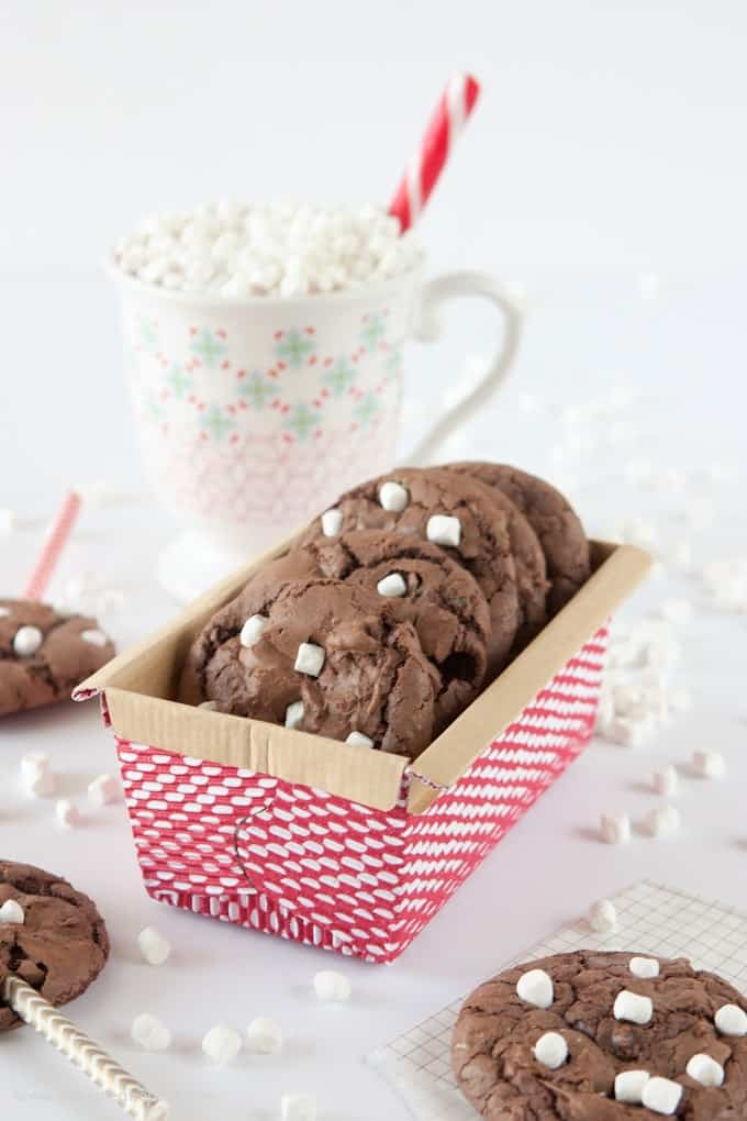 Make these Hot Chocolate Brownie Cookies using a boxed brownie mix & one cup of chocolate cake mix! The cake mix makes them thick, while still keeping a chewy, chocolately texture! Fun way to use those mini marshallows & makes a fun holiday gift idea!